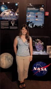 Our LADEE Orbit Determination lead, Lisa Policastri, visited the NASA Wallops Flight Facility prior to launch.  She is standing here in front of the LADEE display, and you can see the LLCD display on the left.